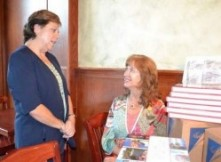Linda Neilsen and Gwen Stephenson receive Loveland 365 books